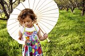 stock photo of flower girl  - An adorable african american little girl in the summertime outdoors