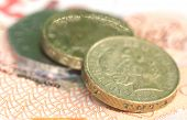 stock photo of british pound sterling note  - Close up of British Pound coins with bank notes - JPG