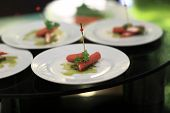 stock photo of buffet lunch  - Stuffed sausages canape on a plate at the buffet - JPG