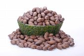 picture of zulu  - pile of unshelled pecan nuts in beaded zulu basket - JPG