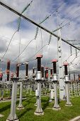 stock photo of substation  - Electrical power substation with current measuring transformers in front.