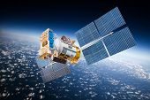stock photo of orbit  - Space satellite orbiting the earth - JPG