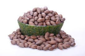 pic of zulu  - pile of unshelled pecan nuts in beaded zulu basket - JPG