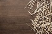 picture of gingivitis  - many wooden toothpicks on the brown table background - JPG