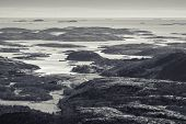 stock photo of fjord  - Monochrome Norwegian coastal landscape with sea and small islands in fjord - JPG