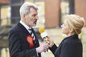 stock photo of politician  - Politician Being Interviewed By Journalist During Election - JPG