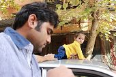 foto of take responsibility  - Indian man is holding his baby - JPG