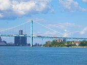 stock photo of mile  - The Detroit River changes direction at the Ambassador International Bridge so that for a few miles it flows east and west before it flows into Lake St - JPG