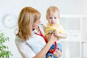 picture of heartbeat  - pediatrician examining heartbeat of little boy with stethoscope - JPG