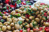 stock photo of pimiento  - Close up view of seasoned green olives in a weekly sicilian market - JPG