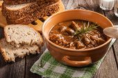 stock photo of mushroom  - Goulash soup with pork and mushrooms - JPG