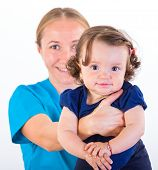picture of babysitter  - Babysitter holding in arms an adorable baby girl - JPG