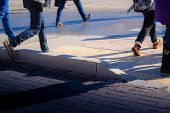 pic of pedestrian crossing  - A group of people cross a road using a pedestrian crossing - JPG