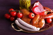 image of deli  - Assortment of deli meats on metal tray on color wooden background - JPG
