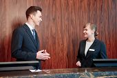 foto of receptionist  - Smile is a best greeting - JPG