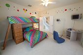 image of bunk-bed  - A Bedroom with a Bunk Bed Interior Shot of a Home - JPG
