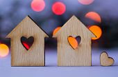 foto of two hearts  - Two wooden houses with hole in the form of heart with little heart on orange and red bokeh background - JPG