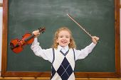 stock photo of violin  - Cute pupil holding violin and violin string at elementary school - JPG
