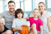 foto of family bonding  - Happy sporty family bonding to each other while sitting in sports club together - JPG