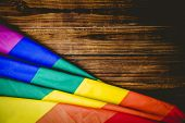 image of studio  - Gay pride flag on wooden table shot in studio - JPG