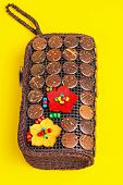 stock photo of keepsake  - Colorful purse with stones and wood set into it  - JPG