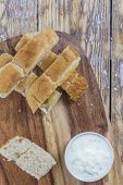 pic of flat-bread  - flat bread sticks with Tzatziki garlic dip on a rustic wooden table - JPG