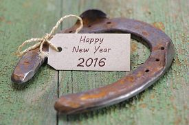 stock photo of year horse  - Happy new year 2016 with horse shoe as lucky charm - JPG