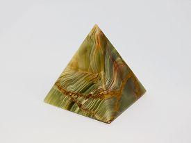 stock photo of tetrahedron  - Pyramid onyx on a white background - JPG