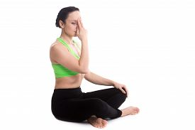 stock photo of pranayama  - Serene girl practicing yoga nadi shodhana pranayama  - JPG