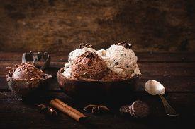 stock photo of ijs  - Sweet homemade ice cream in wooden bowlselective focus - JPG