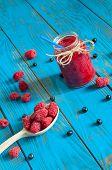 picture of mason  - Mason jar with raspberry jam or marmalade and fresh raspberries - JPG