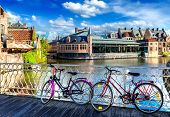 stock photo of common  - Bicycle is very common and popular transport in cities of Europe - JPG