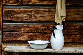 pic of timber  - Place to wash up with white jug and bowl for water and a rugged cloth to dry with - JPG