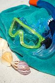 pic of goggles  - Diving equipment Diving goggles snorkel towel and seashells on the beach - JPG