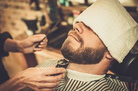 picture of moustache  - Client during beard and moustache grooming in barber shop - JPG
