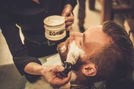 pic of barber razor  - Client during beard shaving in barber shop - JPG