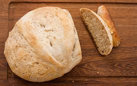 stock photo of home-made bread  - home made bread on wooden board  - JPG