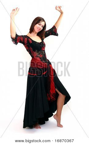 woman dancing Paso Doble in red and black dress clothes.Studio shot on