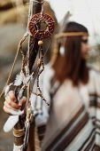 Beautiful Native Indian American Woman Holding Pikestaff With Dreamcatcher On Background Of Woods poster