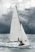 The skiff run out off dangerous storm. Conceptual image. Hope metaphor.