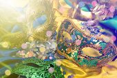 Carnival masks on colorful background poster
