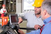 stock photo of factory-worker  - two workers with control panel in factory - JPG