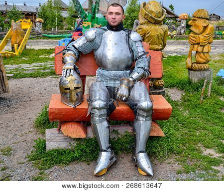 Knight In Armor Among Wooden