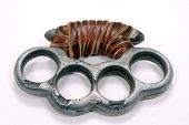 picture of brass knuckles  - aluminum molded brass knuckles close up over white - JPG