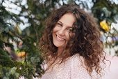 Summer Portrait Of Young Caucasian Curly Haired Woman Smiling Happy At Camera With Perfect Teeth And poster