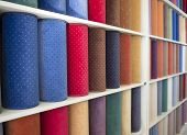 colorful carpets samples on the shelves