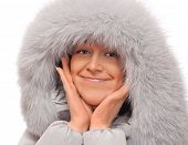 Portrait of young woman in fluffy hood poster