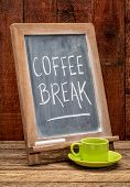 coffee break sign - white chalk handwriting on a blackboard with a cup of coffee poster