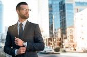 Close Up Profile Portrait Of A Successful Young Bearded Guy In Suit And Glasses. So Stylish And Nerd poster