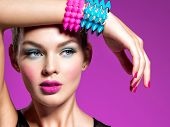 Fashion portrait of a beautiful woman with bright makeup. Closeup face of a beautiful fashion model. poster